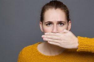 Woman embarrassed by her bad breath at dentist in Waterbury.